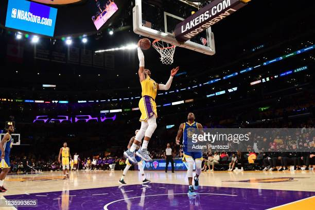 Russell Westbrook of the Los Angeles Lakers dunks the ball during the game against the Golden State Warriors on October 19, 2021 at STAPLES Center in...
