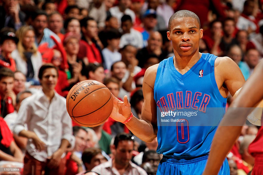 Russell Westbrook #0 of the Oklahoma City Thunder advances the ball against the Miami Heat during a Christmas Day game on December 25, 2012 at American Airlines Arena in Miami, Florida.