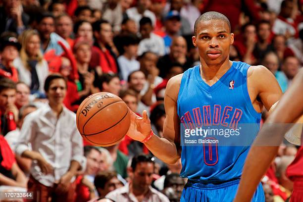 Russell Westbrook of the Oklahoma City Thunder advances the ball against the Miami Heat during a Christmas Day game on December 25 2012 at American...