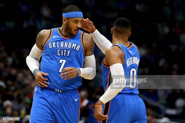 Russell Westbrook of the Oklahoma City Thunder and Carmelo Anthony of the Oklahoma City Thunder react to a play during a NBA game against the New...