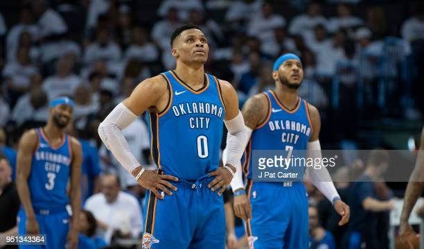 Russell Westbrook of the Oklahoma City Thunder and Carmelo Anthony of the Oklahoma City Thunder watch the game clock during the second half of game 5...