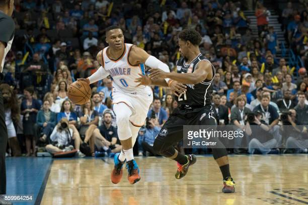 Russell Westbrook of the Oklahoma City Thunder and Casper Ware Jr #21 of Melbourne United battle for the ball during the first half of a NBA...