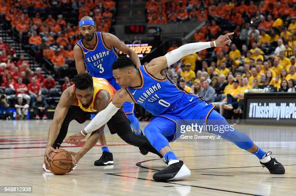 Russell Westbrook of the Oklahoma City Thunder and Donovan Mitchell of the Utah Jazz go for the ball in the second half during Game Three of Round...