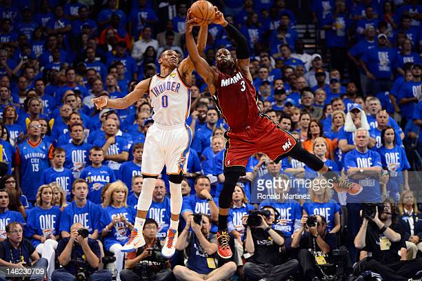Russell Westbrook of the Oklahoma City Thunder and Dwyane Wade of the Miami Heat battle for a ball in the second quarter in Game One of the 2012 NBA...