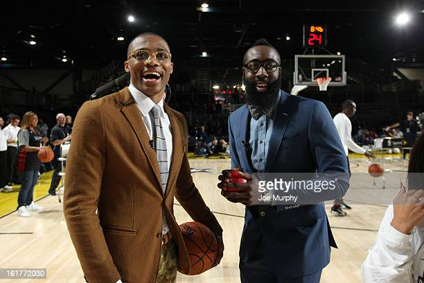 Russell Westbrook of the Oklahoma City Thunder and James Harden of the Houston Rockets laugh during the Sprint Celebrity Game at Jam Session during...