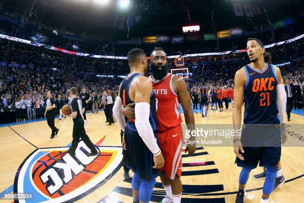 Russell Westbrook of the Oklahoma City Thunder and James Harden of the Houston Rockets hug after the game on December 25 2017 at Chesapeake Energy...