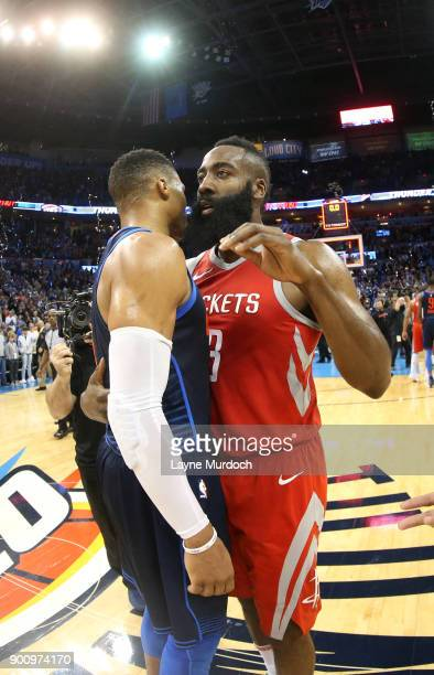 Russell Westbrook of the Oklahoma City Thunder and James Harden of the Houston Rockets exchange a hug after the game between the two teams on...