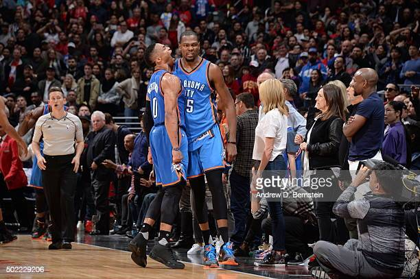 Russell Westbrook of the Oklahoma City Thunder and Kevin Durant of the Oklahoma City Thunder celebrate after the game against the Los Angeles...