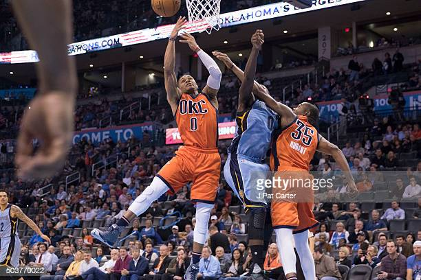 Russell Westbrook of the Oklahoma City Thunder and Kevin Durant of the Oklahoma City Thunder battle JaMychal Green of the Memphis Grizzlies for the...