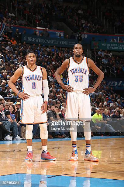 Russell Westbrook of the Oklahoma City Thunder and Kevin Durant of the Oklahoma City Thunder stand on the court during the game against the Houston...