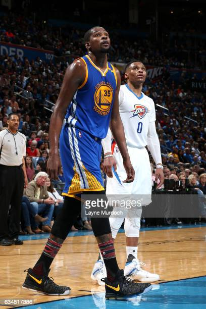 Russell Westbrook of the Oklahoma City Thunder and Kevin Durant of the Golden State Warriors looks on during the game on February 11 2017 at...