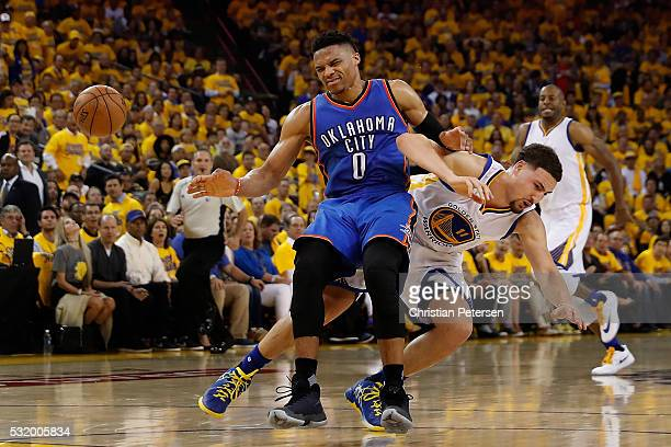 Russell Westbrook of the Oklahoma City Thunder and Klay Thompson of the Golden State Warriors collide while going for the ball during game one of the...