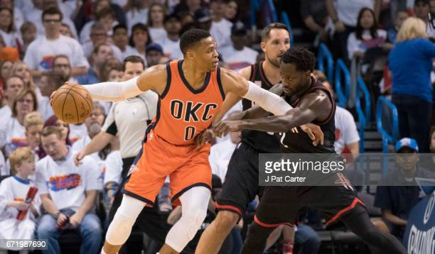 Russell Westbrook of the Oklahoma City Thunder and Patrick Beverley of the Houston Rockets battle for the ball during the first half of Game Four in...