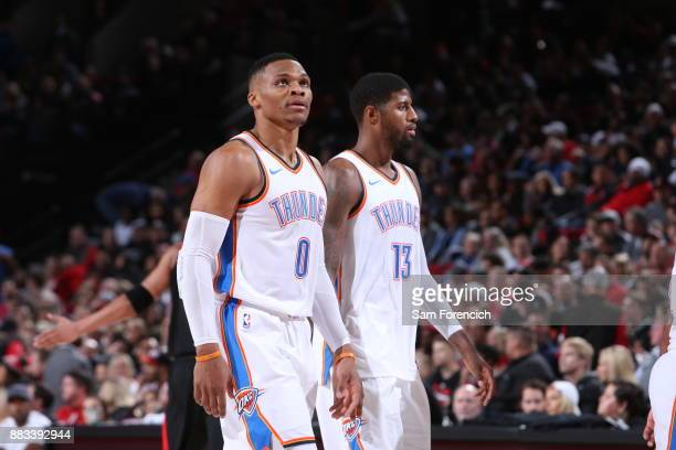 Russell Westbrook of the Oklahoma City Thunder and Paul George of the Oklahoma City Thunder look on from the court during the game against the...