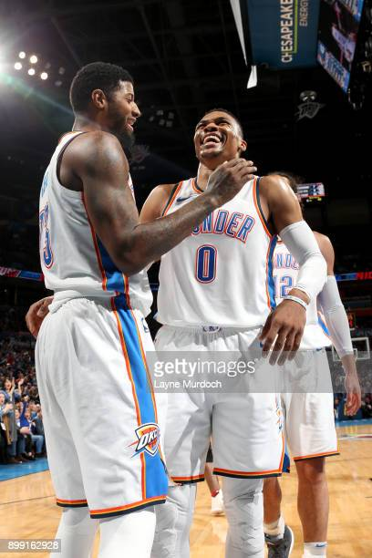 Russell Westbrook of the Oklahoma City Thunder and Paul George of the Oklahoma City Thunder react to a play during the game against the Toronto...