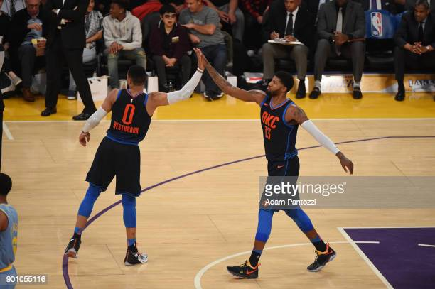 Russell Westbrook of the Oklahoma City Thunder and Paul George of the Oklahoma City Thunder high five during the game against the Los Angeles Lakers...