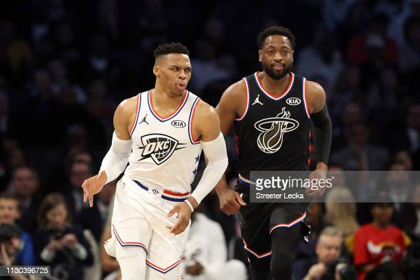 Russell Westbrook of the Oklahoma City Thunder and Team Giannis reacts as Dwyane Wade of the Miami Heat and Team LeBron looks on in the second...