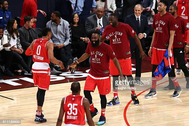 Russell Westbrook of the Oklahoma City Thunder and the Western Conference and James Harden of the Houston Rockets and the Western Conference react...