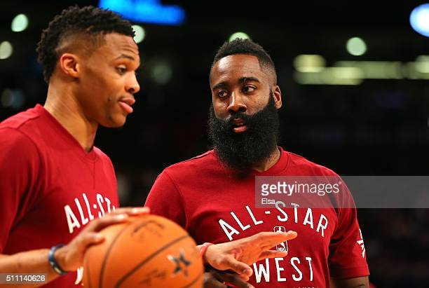 Russell Westbrook of the Oklahoma City Thunder and the Western Conference and James Harden of the Houston Rockets and the Western Conference warm up...
