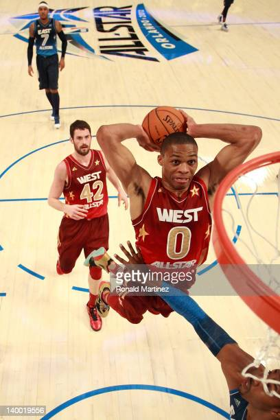 Russell Westbrook of the Oklahoma City Thunder and the Western Conference dunks against Dwight Howard of the Orlando Magic and the Eastern Conference...