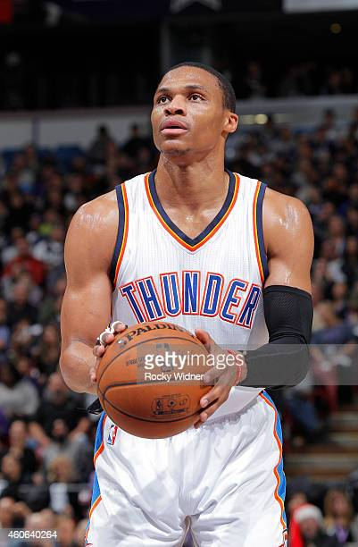 Russell Westbrook of the Oklahoma City Thunder attempts a free throw shot against the Sacramento Kings on December 16 2014 at Sleep Train Arena in...