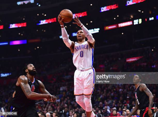 Russell Westbrook of the Oklahoma City Thunder attempts a layup between DeAndre Jordan and Lou Williams of the LA Clippers during the first half at...