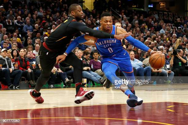 Russell Westbrook of the Oklahoma City Thunder attempts to drive the ball past Dwyane Wade of the Cleveland Cavaliers during the first quarter at...
