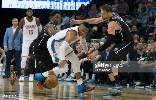 Russell Westbrook of the Oklahoma City Thunder battles Casper Ware Jr #21 and David Anderson of the Melbourne United during the second half of a NBA...