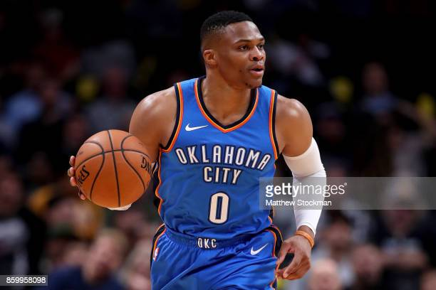 Russell Westbrook of the Oklahoma City Thunder brings the ball down the court against the Denver Nuggets at the Pepsi Center on October 10 2017 in...
