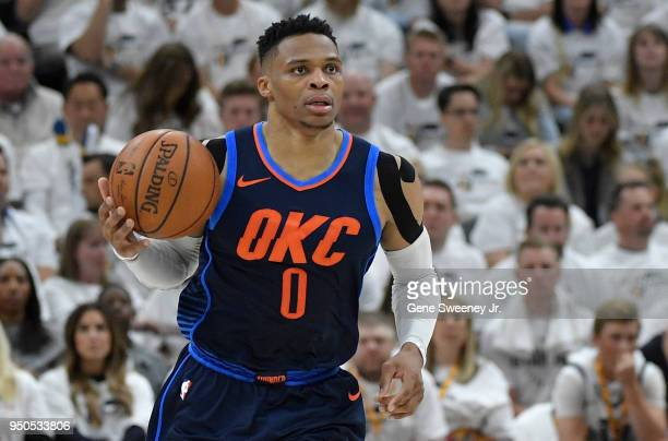 Russell Westbrook of the Oklahoma City Thunder brings the ball up court during Game Four of Round One of the 2018 NBA Playoffs against the Utah Jazz...