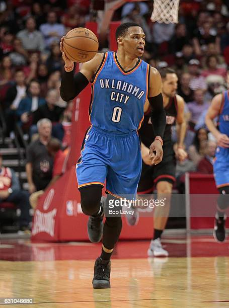 Russell Westbrook of the Oklahoma City Thunder brings the ball up the court in thr fourth quarter against the Houston Rockets at Toyota Center on...