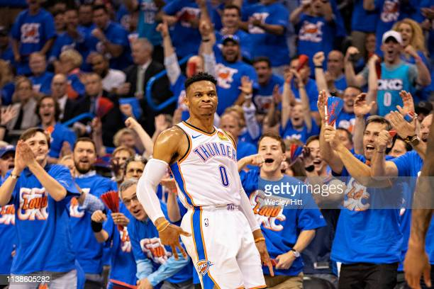 Russell Westbrook of the Oklahoma City Thunder celebrates after making a three point shot during a game against the Portland Trail Blazers during...