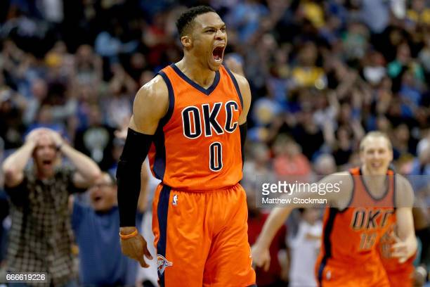 Russell Westbrook of the Oklahoma City Thunder celebrates after scoring a game-winning, three-point shot at the buzzer against the Denver Nuggets at...