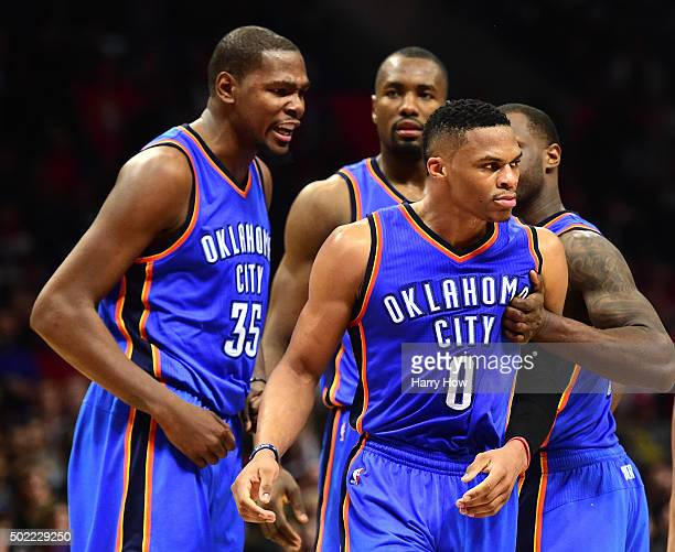 Russell Westbrook of the Oklahoma City Thunder celebrates his defensive play on JJ Redick of the Los Angeles Clippers with Kevin Durant Serge Ibaka...