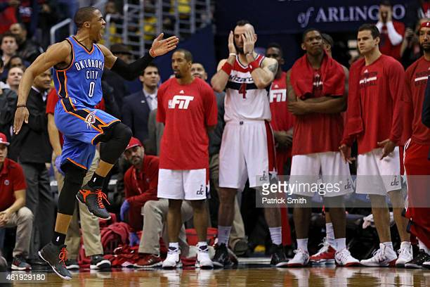 Russell Westbrook of the Oklahoma City Thunder celebrates in front of the Washington Wizards bench after scoring gamewinning shot in overtime at...