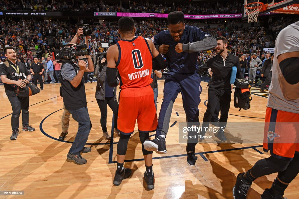 Russell Westbrook #0 of the Oklahoma City Thunder celebrates with teammates after hitting the game winning shot and recording his record breaking 42nd triple-double of the year after the game against the Denver Nuggets on April 9, 2017 at the Pepsi Center in Denver, Colorado.