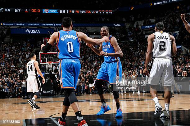 Russell Westbrook of the Oklahoma City Thunder celebrates with Kevin Durant of the Oklahoma City Thunder after the game against the San Antonio Spurs...