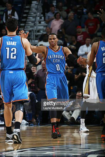 Russell Westbrook of the Oklahoma City Thunder celebrates with teammates during the game against the New Orleans Pelicans on December 2 2014 at the...