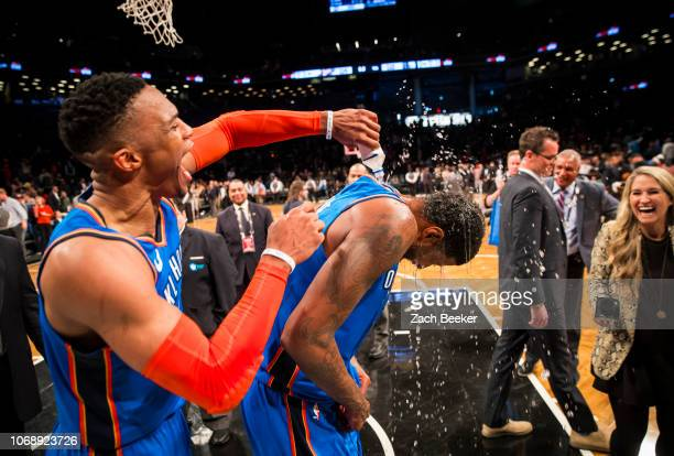 Russell Westbrook of the Oklahoma City Thunder covers Paul George of the Oklahoma City Thunder with water after George hits a three pointer in the...