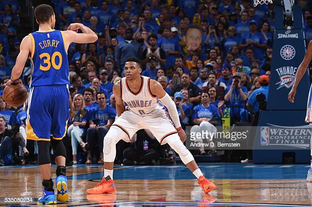 Russell Westbrook of the Oklahoma City Thunder defends against Stephen Curry of the Golden State Warriors in Game Six of the Western Conference...