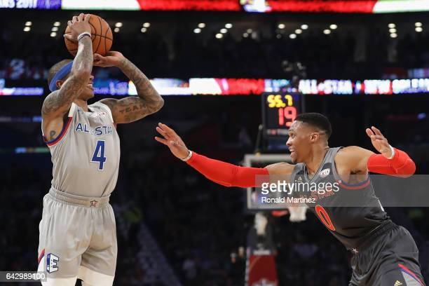 Russell Westbrook of the Oklahoma City Thunder defends Isaiah Thomas of the Boston Celtics in the first half of the 2017 NBA AllStar Game at Smoothie...