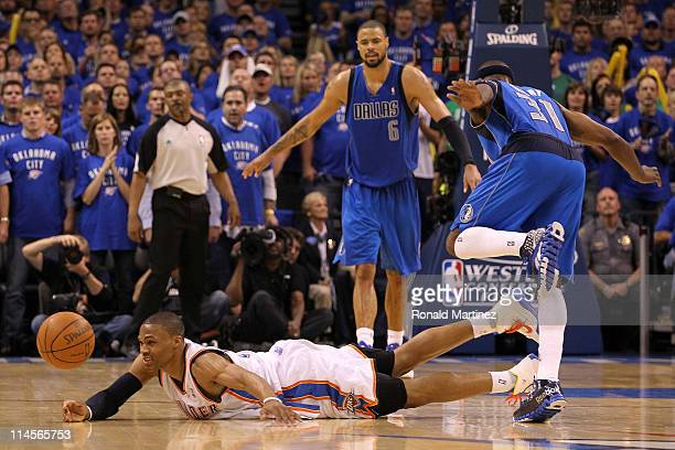 Russell Westbrook of the Oklahoma City Thunder dives for the ball as Jason Terry of the Dallas Mavericks jumps over him in the fourth quarter in Game...