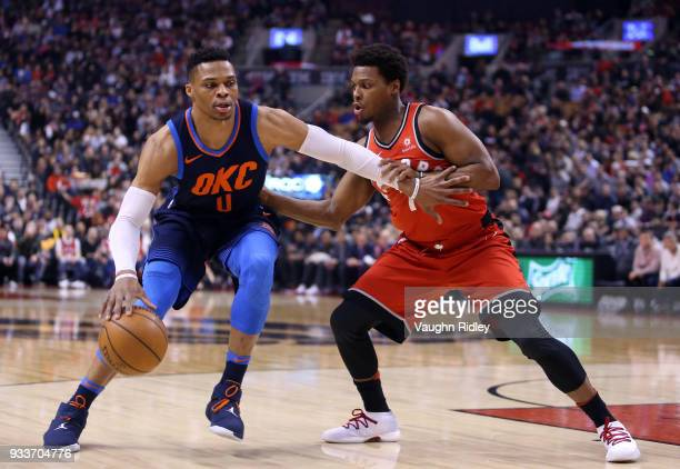 Russell Westbrook of the Oklahoma City Thunder dribbles the ball as Kyle Lowry of the Toronto Raptors defends during the first half of an NBA game at...