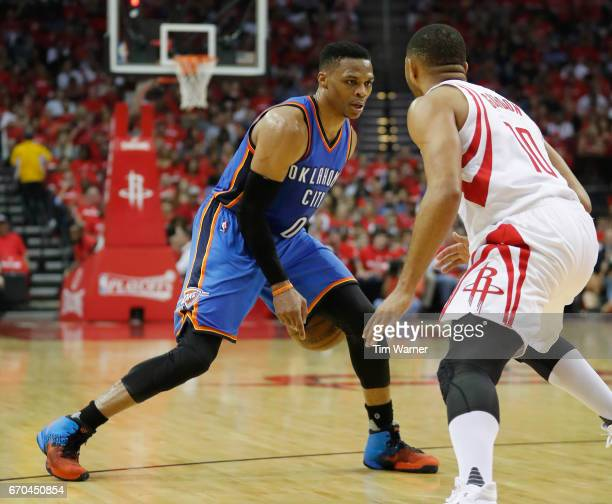 Russell Westbrook of the Oklahoma City Thunder dribbles the ball defended by Eric Gordon of the Houston Rockets in the second half of Game Two of the...