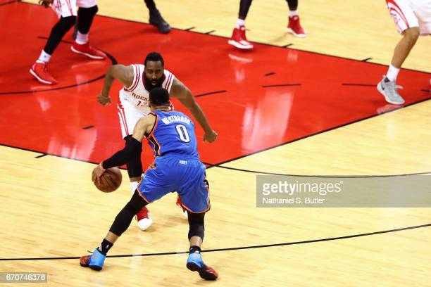 Russell Westbrook of the Oklahoma City Thunder dribbles the ball while guarded by James Harden of the Houston Rockets during Game Two of the Western...