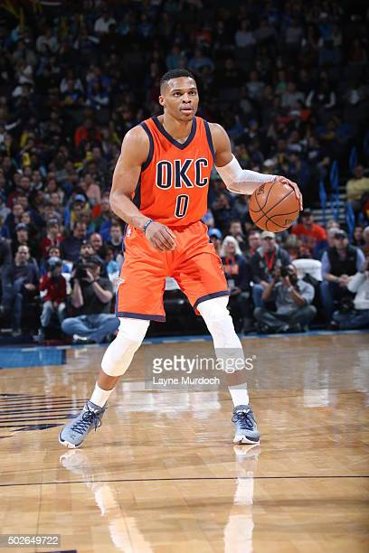 Russell Westbrook of the Oklahoma City Thunder dribbles the ball against the Denver Nuggets on December 27 2015 at Chesapeake Energy Arena in...