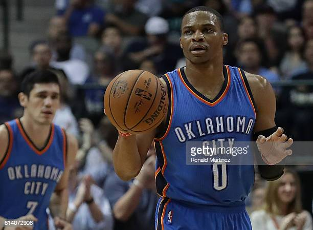 Russell Westbrook of the Oklahoma City Thunder dribbles the ball against the Dallas Mavericks during a preseason game at American Airlines Center on...