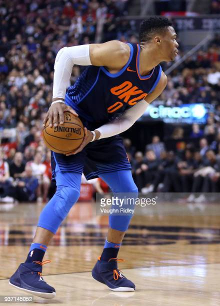 Russell Westbrook of the Oklahoma City Thunder dribbles the ball during the first half of an NBA game against the Toronto Raptors at Air Canada...