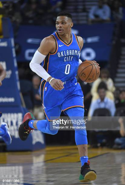 Russell Westbrook of the Oklahoma City Thunder dribbles the ball up court against the Golden State Warriors during the first half of their NBA...