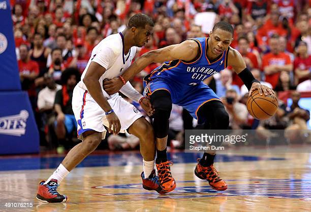 Russell Westbrook of the Oklahoma City Thunder drives against Chris Paul of the Los Angeles Clippers in Game Six of the Western Conference Semifinals...